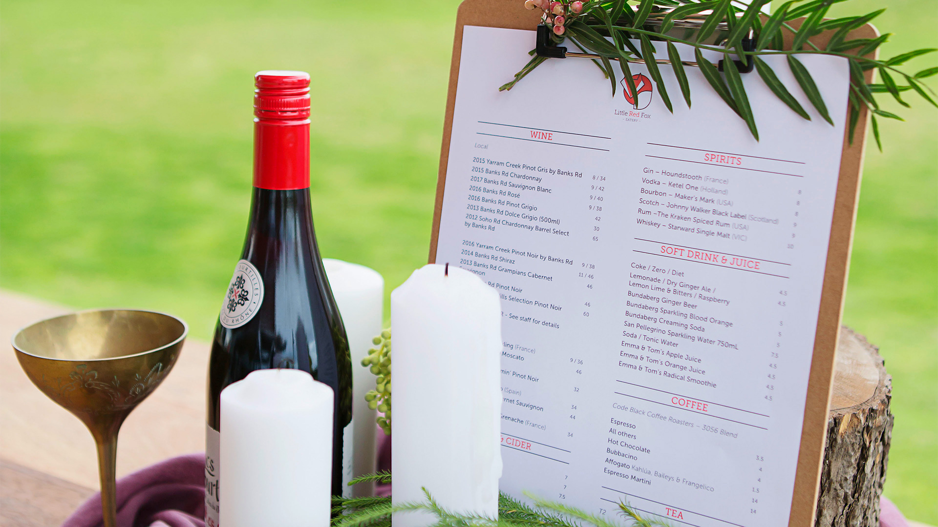 Little Red Fox Eatery menu in outdoor wedding setting