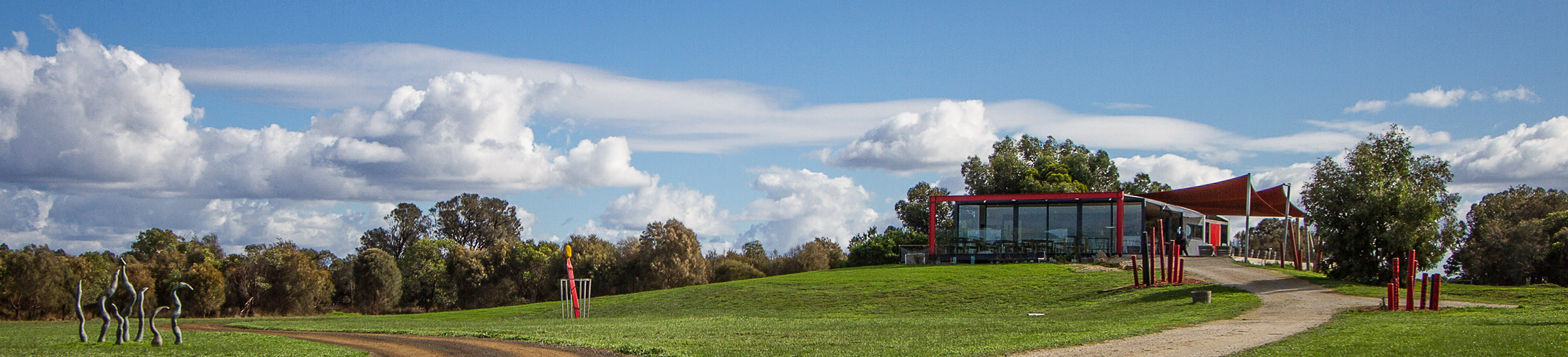Wide shot of Little Red Fox Eatery and the sculptures across the landscape